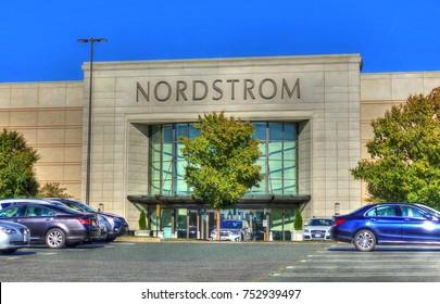 HDR image, Nordstrom retailer storefront entrance, car parking lot - Peabody, Massachusetts USA - October 18, 2017