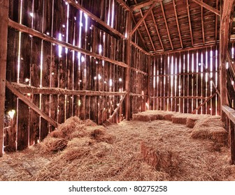 HDR image of an old Barn with the sun streaming from outside and straw and hay on the floor of the hayloft