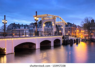 HDR image of the skinny bridge in Amsterdam, the Netherlands, early in the morning in winter