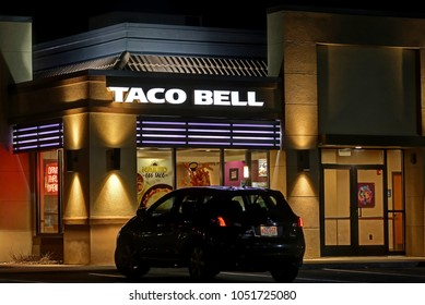 HDR image, Taco Bell restaurant, front window entrance signage - Revere, Massachusetts USA - March 10, 2018