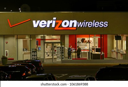 HDR image, Verizon Wireless retail storefront, customers shopping mobile devices - Saugus, Massachusetts USA - March 23, 2018