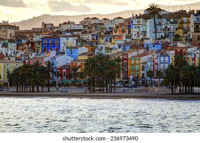 HDR image of Villajoyosa beach and colored houses, in Spain.