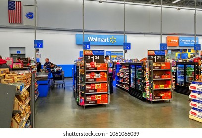 HDR image, Walmart retail store cash register check out lane aisles, customers shopping, paying - Saugus, Massachusetts USA - April 2, 2018