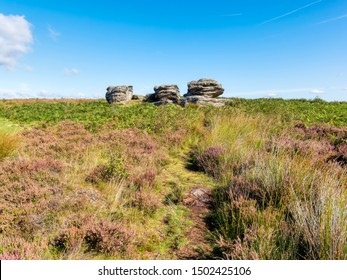 HDR image of the weathered gritstone outcrop known as Three Ships on Birchen Edge in Derbyshire.