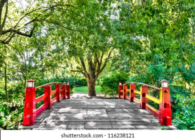 HDR image-Pedestrian Bridge surrounded by trees, flowers and leaves.
