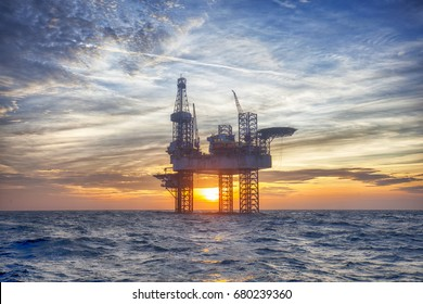HDR of Offshore Jack Up Rig in The Middle of The Sea at Sunset Time