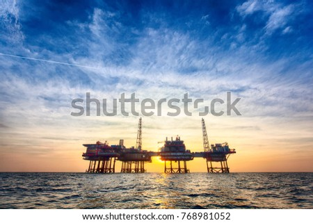 HDR offshore oil platform at sunset