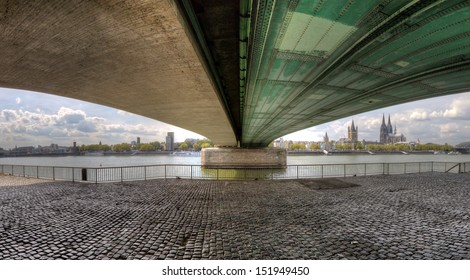 HDR Panorama under the Deutzer Bridge looking back to central Cologne.