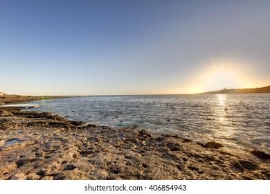 HDR photo of sunrise behind sea at Malta, St. Paul