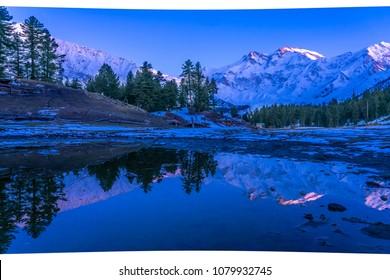 HDR photography of sunset light on Nanga Parbat mountain  with water reflection ,gilgit-baltistan , Pakistan