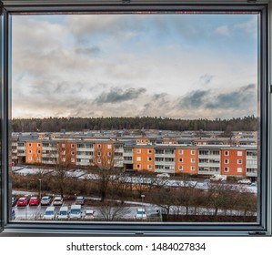 HDR picture of a 1960's Swedish residential area. Three storey raws of buildings near the forest. View of out of the window. Winter, running clouds, watercolor effect, frame. Täby, Stockholm, Sweden