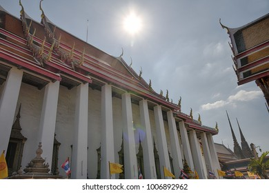 HDR picture of Wat Pho Thai temple with cloud and sun in mid day