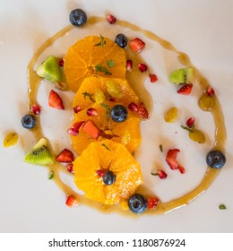 HDR Upright Gourmet Caramel Crepe with Fresh Oranges,  Blueberries, and Pomegranate Seeds in Sage Honey Pool