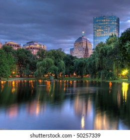 A HDR view of the Hancock towers in Boston viewed across the pond at the Public Gardens
