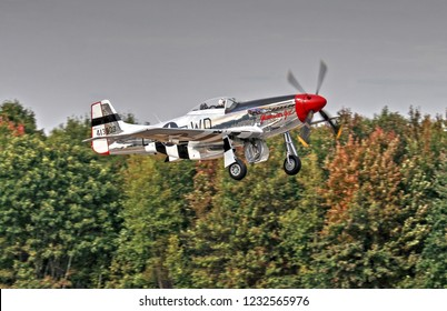 HDR Warbird North American P-51 Mustang taking off runway, Manchester New Hampshire USA air show, September 24, 2005