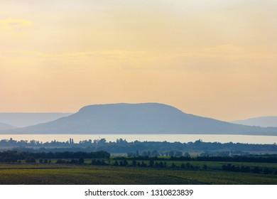 he Badacsony mountain with Lake Balaton at sunset in Hungary