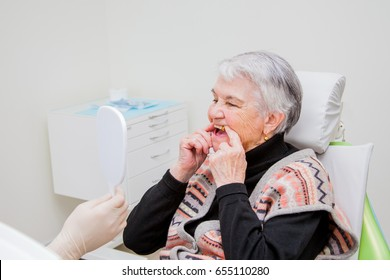 he elderly woman on prosthetics of a teeth at the orthopedist