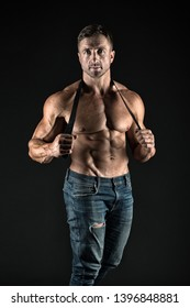 He got perfect torso. muscular man hold leather belt. fetish. bdsm love game. Sportsman with muscular chest belly. Sport fitness. Masculinity and brutality. man with sexy muscular torso look brutally.