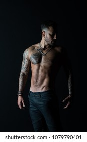 He got perfect torso. Tattoo man with sexy bare torso in jeans. Bearded macho with tattooed body. Athlete with sexy bare torso in jeans. Sportsman with muscular chest and belly. Sport and fitness.