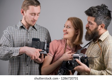 He got some great shots. Retro style woman and men hold analog photo cameras. Group of photographers with retro cameras. Paparazzi or photojournalists with vintage old cameras. Photography studio.