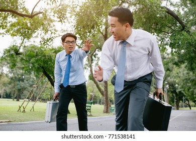 he image of a businessman running the race. In the background of the park.