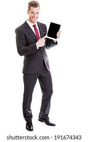 He knows what is good for you! - full length shot of a confident young businessman presenting empty space on a modern tablet pc