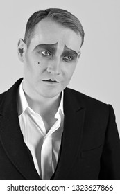 He is made to be an actor. Man with mime makeup. Mime with face paint. Mime artist. Theatre actor miming. Stage actor playing. Theatrical performance art and pantomime. Tragedian performer. Tragedy.