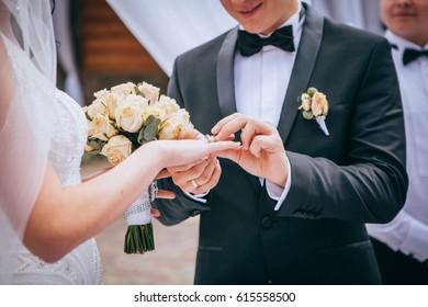 He put her wedding rings on her finger
