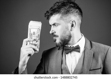He respects money. Currency broker with bundle of money. Bearded man holding cash money. Rich businessman with us dollars banknotes. Making money with his own business. Business startup loan.
