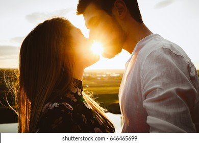 he and she on a nature outing.Romance and love.kiss in the sunset sun