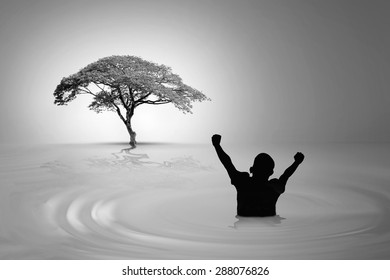 He is walking in flooded both fists in delight seeing at the huge tree goal and hopes to have survived the disaster.