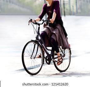 he woman on the bike after work. Urban scene.