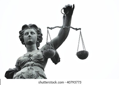 head and arm of a justice statue