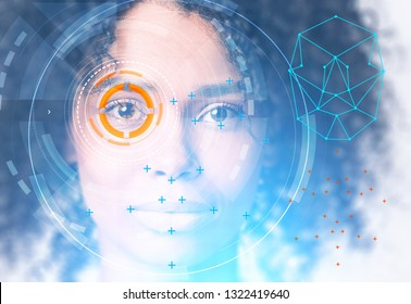 Head of beautiful young African American woman with face recognition technology and HUD around eye. Toned image