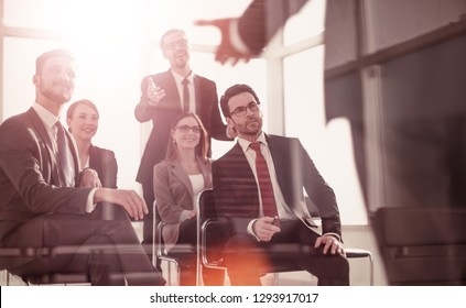 head and business team at a business meeting to discuss