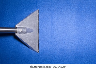 Head of carpet extraction cleaner on Blue carpet from top view