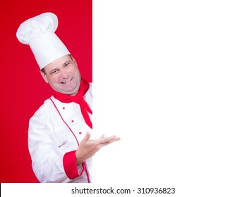 Head chef offers a blank menu. Chef showing white board. Chef offers a dining bid paper on red background. Chef cook invite you on lunch menu. Restaurant menu empty poster.Blank billboard with cook.