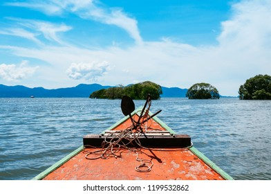 Head of colourful Thai fishing boat with iron rustic anchor and rope, Koh Chang island view