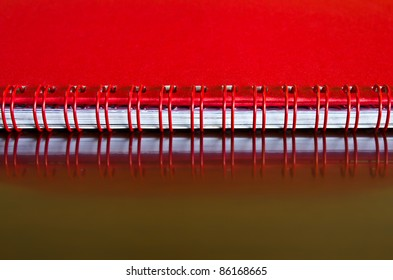 Head of the desktop red calendar placed in a horizontal position.