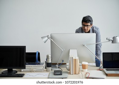 Head engineer checking information on computer monitor