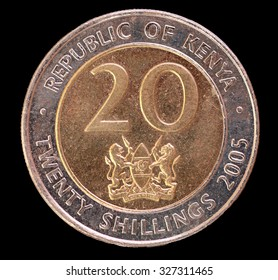 The head face of a 20 shilling coin, issued by the Republic of Kenya in 2005, depicting the national emblem of Kenya. Image isolated on black background