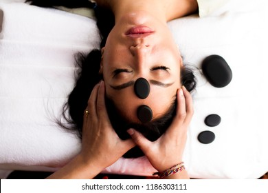 Head and face massage with stones