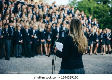 Head girl gives a speech to students at a boarding school
