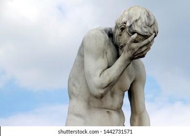 Head in hands: Facepalm statue in Paris, France