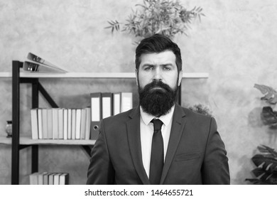 Head of human resources department. Man bearded serious office background. Provide consultation to management on strategic staffing plans. Office staff. HR director. HR management. HR job description.