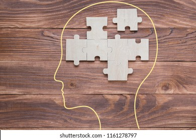 Head with jigsaw puzzle of abstract brain. Creative medical or business concept.