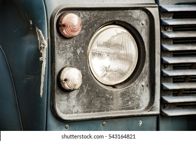 Head lamp on blue truck with dent high contrast