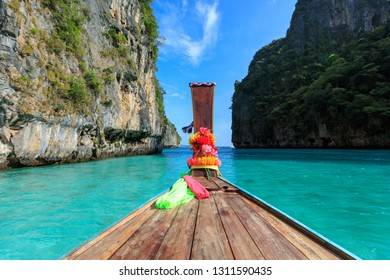 head long tail boat on the sea and cliff rock mountain background high season tourists summer holiday at phi phi island kra bi Thailand