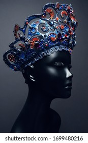Head of mannequin in creative metal crown with jewels