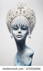 Head of mannequin in creative white kokoshnick with jewels and pearls
